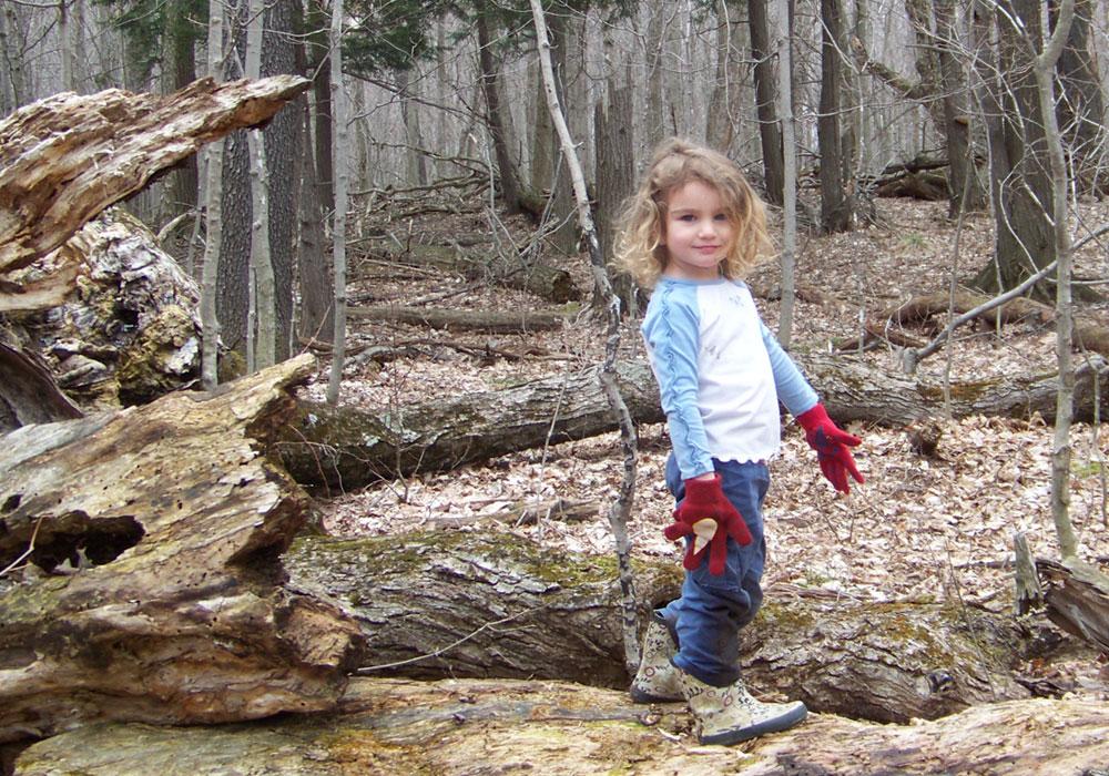 Little girl on a log