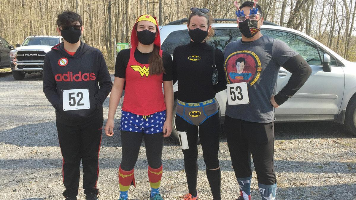 soggy sneakers runners dressed as super heroes
