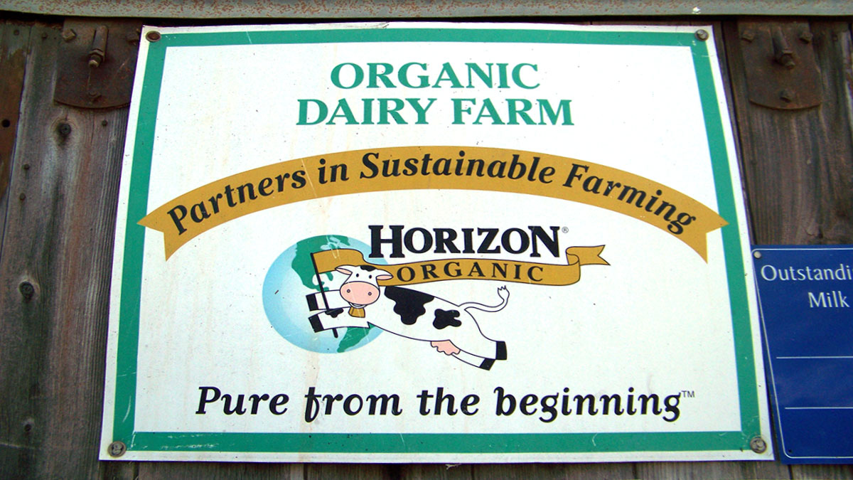 Young dairy farm sign